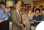 Tony Marro seen enjoying the retirement Celebration held for him at the Melville Office of Newsday on Tuesday, August 12, 2003. (Photo / Jim Peppler).