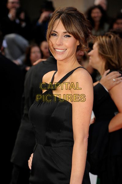 ALEX JONES .Attending the Philips British Academy Television Awards, Grosvenor house Hotel, Park Lane, London, England, UK, May 22nd 2011..arrivals TV Baftas Bafta half length black dress bow sleeveless straps side smiling hair up .CAP/WIZ.© Wizard/Capital Pictures.