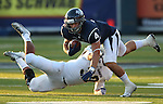 Nevada runningback Kendall Brock runs against UC Davis defender Ryan Dimino during the first half of a college football game in Reno, Nev., on Saturday, Sept. 7, 2013. Brock led Nevada with 116-yards in the 36-7 Nevada victory. (AP Photo/Cathleen Allison)