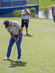 Justin Suh putts on the 18th green during the Barracuda Championship PGA golf tournament at Montrêux Golf and Country Club in Reno, Nevada on Friday, July 26, 2019.