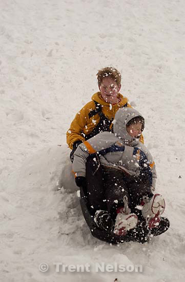 Todd Rimmasch, Noah Nelson sledding at Sugarhouse park<br />