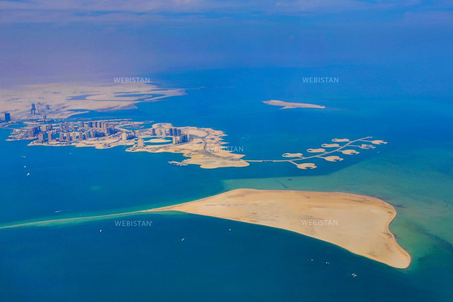 Qatar, Doha.<br /> Aerial view of Doha bay.<br /> Qatar is one of the Arab peninsular emirates, on the Persian Gulf shoreline. Bordered by Saudi Arabia, Qatar's economy relies on oil and gas. Being the world's fourth-largest gas exporter, gas remains the major driver of Qatar's economy. The emirate is governed by Sheikh Tamim bin Hamad Al Thani who became at the age of 33 Emir of Qatar on 25 June 25th, 2013 after his father's abdication. He is the youngest emir at the head of an Arab State.<br /> On June 5th, 2017, Saudi Arabia, the United Arab Emirates, Egypt, Bahrain, Yemen, Libya, Mauritania, the Maldives, and Mauritius broke off diplomatic relations with Qatar, accusing the emirate of supporting several terrorist groups. As its Gulf neighbours enforced the closure of all land, air and sea borders to Qatar, the country is quarantined. <br /> <br /> &quot;aerial view&quot; series.<br /> <br />Qatar, Doha.<br />Vue a&eacute;rienne de la baie de Doha.<br />Le Qatar est l'un des &eacute;mirats du Moyen-Orient de la p&eacute;ninsule du golfe persique. Voisin de l'Arabie Saoudite, l'&eacute;conomie qatarie trouve son &eacute;quilibre gr&acirc;ce &agrave; la vente de gaz naturel dont il est le quatri&egrave;me vendeur au monde, avant la vente de p&eacute;trole. L'&eacute;mirat est dirig&eacute; par l'&eacute;mir Tamim ben Hamad Al Thani, qui succ&egrave;de le 25 juin 2013 &agrave; son p&egrave;re alors qu'il n'a que 33 ans, et devient alors le plus jeune chef d'&Eacute;tat du monde arabe.<br />Le 5 juin 2017, l'Arabie Saoudite, les &Eacute;mirats arabes unis, l'&Eacute;gypte, Bahre&iuml;n, le Y&eacute;men, la Libye, la Mauritanie, les Maldives et l'&icirc;le Maurice rompent toute relation diplomatique avec le Qatar, l'accusant de soutenir divers groupes terroristes. L'&eacute;mirat est alors mis sous quarantaine avec la fermeture des fronti&egrave;res terrestres, a&eacute;riennes et maritimes. <br /><br />S&eacute;rie &quot;vue a&eacute;rienne&quot;.
