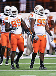 Oklahoma State Cowboys defensive tackle Nigel Nicholas (89) and Oklahoma State Cowboys defensive tackle Chris Donaldson (95) get ready for some action during the game between the Oklahoma State Cowboys and the University of Texas in Austin Texas Longhorns at the Daryl K. Royal- Texas Memorial Stadium in Austin, Texas. The Oklahoma State Cowboys defeated the Texas Longhorns 33 to 16.