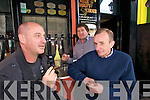 Allen Powzi, Peter Murphy Proprietor and Billy O'Mahony smoking outside Willie Darcy's bar in the square, Tralee on Monday.