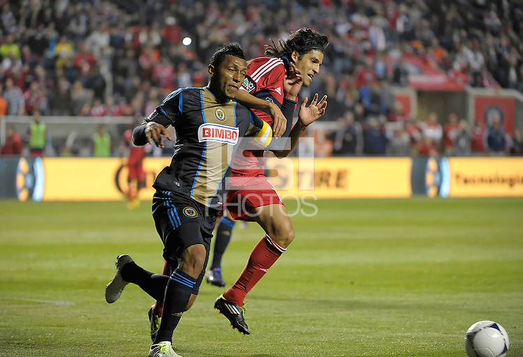 Philadelphia Union defender Carlos Vales (2) holds off Chicago Fire midfielder Sebastian Grazzini (10).  The Chicago Fire defeated the Philadelphia Union 1-0 at Toyota Park in Bridgeview, IL on March 24, 2012.