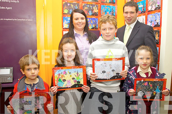 The winners of the AIB Cahersiveen Halloween coloring competition with their winning entries, picture here on Thursday receiving their prizes were front l-r; Sean O'Sullivan, Grace Curran, Fionn O'Connell, Katie O'Connell, back l-r; Amy Lynch(AIB) & Brian Gannon(AIB Branch Manager).