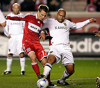 Real Salt Lake defender Robbie Russell (3) pokes the ball away from Chicago Fire midfielder Chris Rolfe (17).  Real Salt Lake defeated the Chicago Fire in a penalty kick shootout 0-0 (5-4 PK) in the Eastern Conference Final at Toyota Park in Bridgeview, IL on November 14, 2009.