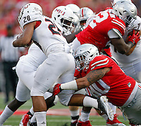Ohio State Buckeyes defensive lineman Tommy Schutt (90) tackles Northern Illinois Huskies running back Joel Bouagnon (28) in the 3rd quarter of their game at Ohio Stadium on September 19, 2015.  (Dispatch photo by Kyle Robertson)