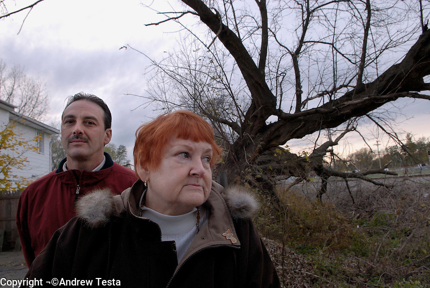 USA. Albany. 08 November 2007..Joe Lito with his mother Patricia in their garden which backs onto the National Lead Industries site. .©Andrew Testa