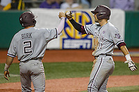 Texas A&M Aggies outfielder J.B. Moss (11) celebrates with teammate second baseman Ryne Birk (2) after he scored during a Southeastern Conference baseball game against the LSU Tigers on April 24, 2015 at Alex Box Stadium in Baton Rouge, Louisiana. LSU defeated Texas A&M 9-6. (Andrew Woolley/Four Seam Images)