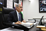 Palestinian Prime Minister Mohammad Ishtayeh charis the weekly meeting of his government, in the West Bank city of Ramallah, on September 23, 2019. Photo by Prime Minister Office
