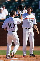 Nathan Melendres #10 and Chris Pelaez #22 of the Miami Hurricanes celebrate at home plate following Melendres' 2-run home run against the Florida State Seminoles at the 2010 ACC Baseball Tournament at NewBridge Bank Park May 26, 2010, in Greensboro, North Carolina.  The Hurricanes defeated the Seminoles 9-3.  Photo by Brian Westerholt / Four Seam Images