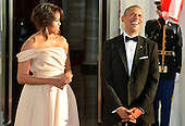 U.S. President Barack Obama (R) laughs as he and First Lady Michelle Obama  await for the arrival of leaders from the five Nordic countries for a State Dinner, at the White House, May 13, 2016, in Washington, DC. They leaders were expected to discuss terrorism, the environment, Arctic issues and trade.<br /> Credit: Mike Theiler / Pool via CNP