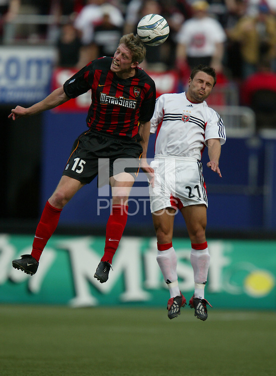 17 April 2004: MetroStars John Wolyniec battles the ball in the air with DC United Dema Kovalenko at Giants' Stadium in East Rutherford, New Jersey.  MetroStars defeated DC United, 3-2.