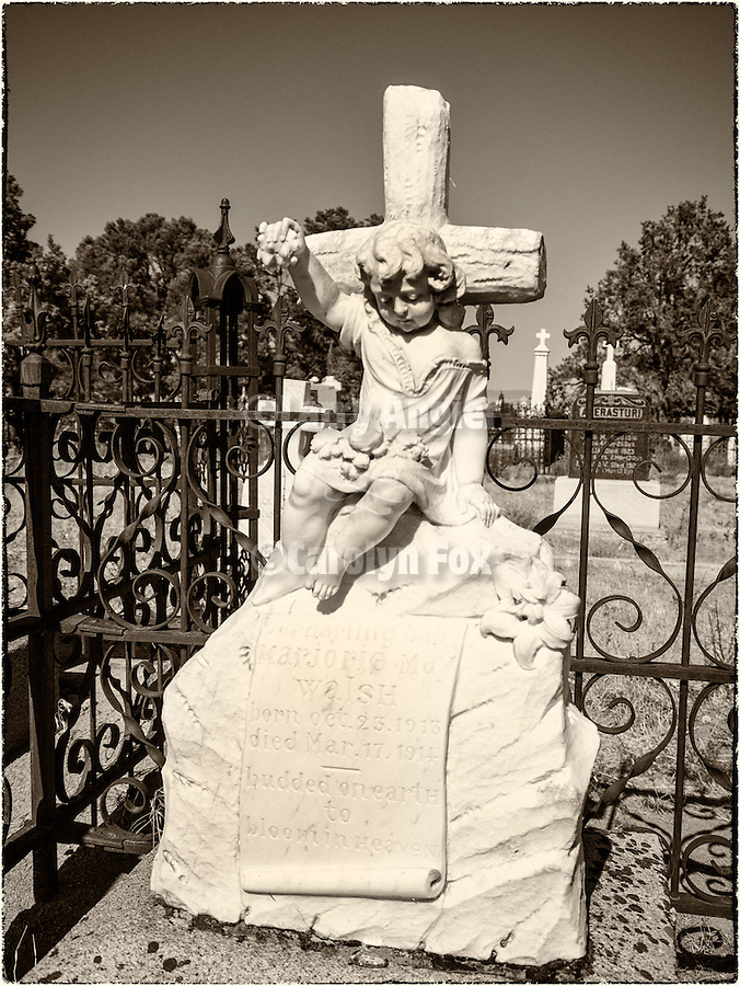 Angels carved in marble in the cemetery, Austin, Nev.
