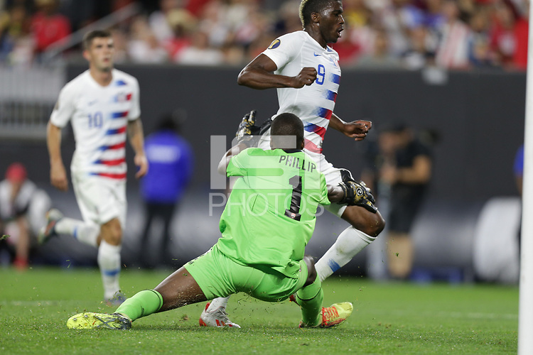 CLEVELAND, OHIO - JUNE 22: Marvin Phillip #1, Gyasi Zardes #9 during a 2019 CONCACAF Gold Cup group D match between the United States and Trinidad & Tobago at FirstEnergy Stadium on June 22, 2019 in Cleveland, Ohio.