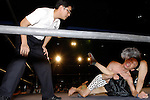 "May 17, 2008, Tokyo, Japan - ""Orochi"" and ""E.T."" grapple  as referee Shinsuke Funabashi watches.  (Photo by Tony McNicol/AFLO)"