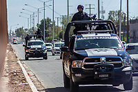 MEXICALI, MEXICO - April 5 Units of the Mexican Federal Police patrol the street next to the US-Mexico Border Fence on April 5, 2019 in Mexicali, Mexico.<br /> President Trump on Friday visited Calexico, a small city in a largely agricultural region between Arizona and the Pacific, to inspect an upgraded portion of fencing and to meet with law enforcement. That's more attention than usual for a border town that locals say is defined by its interconnection with Mexico, its infernal summers and its labor-based economy. <br /> (Photo by Luis Boza/VIEWpress)