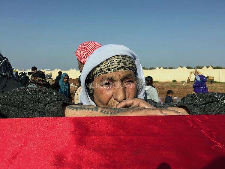 28/2/2015--Kobane,Syria-- a portrait of an old woman (Amina Eso) whose grandson was killed in the fight, resting after crying.