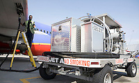 5/5/2008 10:41:49 AM -- Seattle, WA, U.S.A.Aircraft Service International Group employee Abdi Abdi, 37, monitors the refueling of a Southwest Airlines jet from a fuel hydrant cart at the Seattle-Tacoma International Airport in Seattle Monday May 5, 2008. In an effort to reduce emissions, the airport has replaced fueling trucks with hydrants that pipe fuel directly to the airplanes at the gate. .