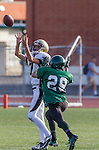Torrance, CA 10/03/13 - Danny Schubert (Peninsula #7) and unidentified South Torrance player(s) in action during the Peninsula vs South Torrance Freshmen football game at South Torrance High School.