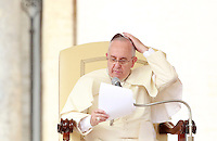 Papa Francesco tiene l'udienza generale del mercoledi' in Piazza San Pietro, Citta' del Vaticano, 15 ottobre 2014.<br /> Pope Francis adjusts his skull cap blown by the wind during his weekly general audience in St. Peter's Square at the Vatican, 15 October 2014.<br /> UPDATE IMAGES PRESS/Isabella Bonotto<br /> <br /> STRICTLY ONLY FOR EDITORIAL USE