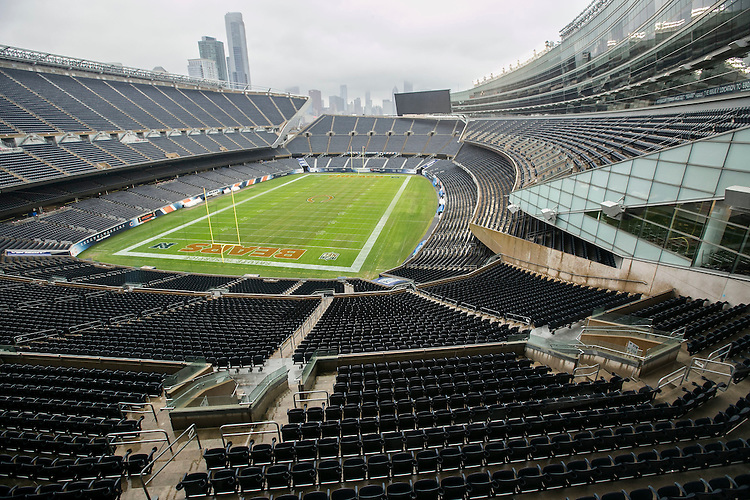 """DePaul business students look out overSoldier Field, home to the NFL's Chicago Bears,Monday, Nov. 28, 2016 as part of the """"Behind the Scenes with Chicago Sports Organizations"""". Andy Clark, director of Sports Management Programs in the Driehaus College of Business, led the students across the city during the week-long, winter intersession class as they visited with some of Chicago's iconic sports teams, including the Cubs, Bears, Blackhawks and Bulls. The students were given behind the scenes access to the major sports organizations and venues, all while learning about sports management and marketing. (DePaul University/Jamie Moncrief)"""