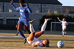29 November 2013: Virginia Tech's Jazmine Reeves (center) tumbles to the ground after a challenge by Duke's Natasha Anasi (4). The Virginia Tech University Hokies played the Duke University Blue Devils at Thompson Field in Blacksburg, Virginia in a 2013 NCAA Division I Women's Soccer Tournament Quarterfinal match. Virginia Tech won the game 3-0.