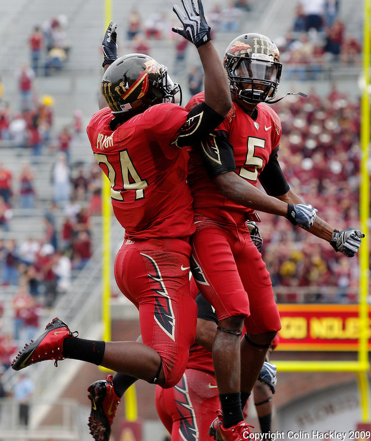 TALLAHASSEE, FL 11/21/09-FSU-MARY FB09 CH45-Florida State's Lonnie Pryor, left, celebrates his 50-yard touchdown run with Greg Reid during first half action against Maryland Saturday at Doak Campbell Stadium in Tallahassee. .COLIN HACKLEY PHOTO