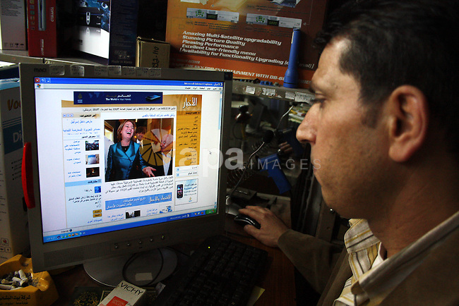 A Palestinian man go on the internet in his shop in the West Bank city of Hebron on 24 January 2011 concerning the 1,600 secret documents published by Al-Jazeera about the Israeli Palestinian negotiations. Palestinian officials Monday questioned the authenticity of documents published by al-Jazeera, which the Qatari television channel claims show Palestinian negotiators offering Israel 'unprecendented' concessions over occupied East Jerusalem.. Photo by Najeh Hashlamoun