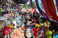 Survivors of the Zamboanga City rebel attack take refuge in the city's largest stadium in Zamboanga, Mindanao, The Philippines on November 4, 2013. These Internally Displaced People (IDP) had taken refuge in the stadium after surviving the 3 week long attack by MNLF rebels and try to cope with the situation by setting up small shops in their tents on the running track and in the breachers. Photo by Suzanne Lee for SPRINT-IPPF