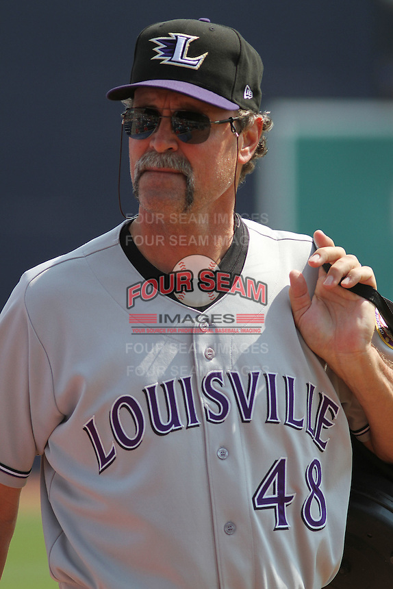 Louisville Bats pitching coach Ted Power #48 making his way from the bullpen to the dugout before a game against the Durham Bulls at Durham Bulls Athletic Park on May 2, 2012 in Durham, North Carolina. Durham defeated Louisville by the score of 7-5. (Robert Gurganus/Four Seam Images)
