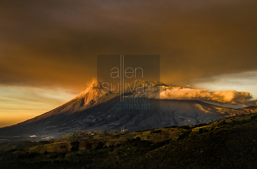 Guatemala's Fuego volcano erupts at sunrise on Monday, Nov. 19, 2018, sending up a large cloud of ash. Dormant Acatatenango volcano sits at right.
