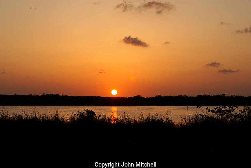 Sun setting over lake Coba, Coba, Quintana Roo, Mexico.