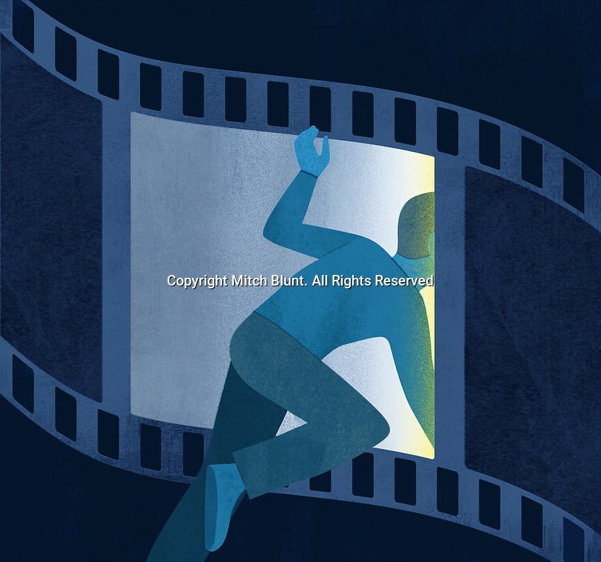 Man climbing through film strip ExclusiveImage