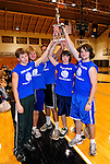14 November 2010: The boys team from Lake Region Union High School hoist their trophy after winning the 2010 Vermont State Volleyball Championship at Saint Michael's College in Colchester, Vermont. Participating schools included: the Enosburg Falls Hornets, the Lake Region Union Rangers, the Lyndon Institute Vikings, and the VCS Flying Turtles. The Girls Championship went to Vermont Commons School. Mandatory Credit: Ed Wolfstein Photo.