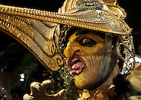 A member of Sao Clemente samba school performs during a carnival parade at the Sambadrome, Rio de Janeiro, Brazil, February 16, 2015.