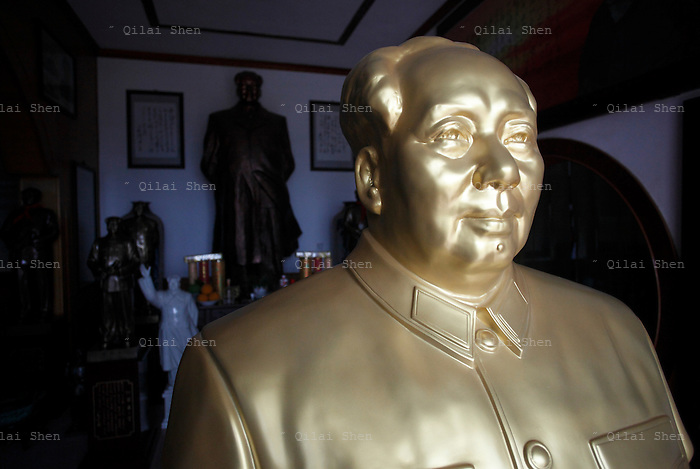 "Mao statues and souvenirs stands in the home of a ""Red"" memorabilia collector and manufacturer near the birthplace of Mao Zedong, in Shaoshan, Hunan Province, China on 12 August 2009."