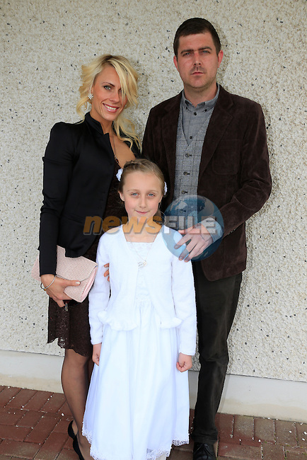 Sinead Sweeney, Martin Sweeney and Helina Tumova at first communion in Star of the Sea Church in Mornington.<br /> Picture: www.newsfile.ie