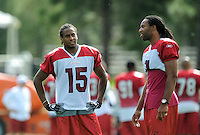 Jul 31, 2009; Flagstaff, AZ, USA; Arizona Cardinals wide receiver (15) Steve Breaston talks with Larry Fitzgerald during training camp on the campus of Northern Arizona University. Mandatory Credit: Mark J. Rebilas-