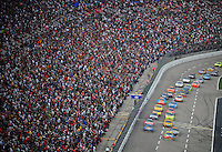 Nov. 8, 2009; Fort Worth, TX, USA; NASCAR Sprint Cup Series driver Kyle Busch (18) leads the field during the Dickies 500 at the Texas Motor Speedway. Mandatory Credit: Mark J. Rebilas-