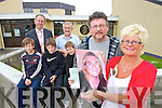 "Ann and John Buggy (Right) with a photo of their son Adam who died last year. The Holy Family school have named their annual charity walk In honour  Adam, who went to school at Holy Family and was one of the first boys to do the walk, it is now ""The Adam Buggy Annual walk"", also in photo from left Cian Hill, Principal Ed O'brienSean Lyons, Rory O'Kelly, Sean Lyons and Marcus Nolan."