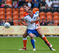 Blackpool's Ben Heneghan battles with Portsmouth's Oli Hawkins<br /> <br /> Photographer Alex Dodd/CameraSport<br /> <br /> The EFL Sky Bet League One - Blackpool v Portsmouth - Saturday August 11th 2018 - Bloomfield Road - Blackpool<br /> <br /> World Copyright &copy; 2018 CameraSport. All rights reserved. 43 Linden Ave. Countesthorpe. Leicester. England. LE8 5PG - Tel: +44 (0) 116 277 4147 - admin@camerasport.com - www.camerasport.com