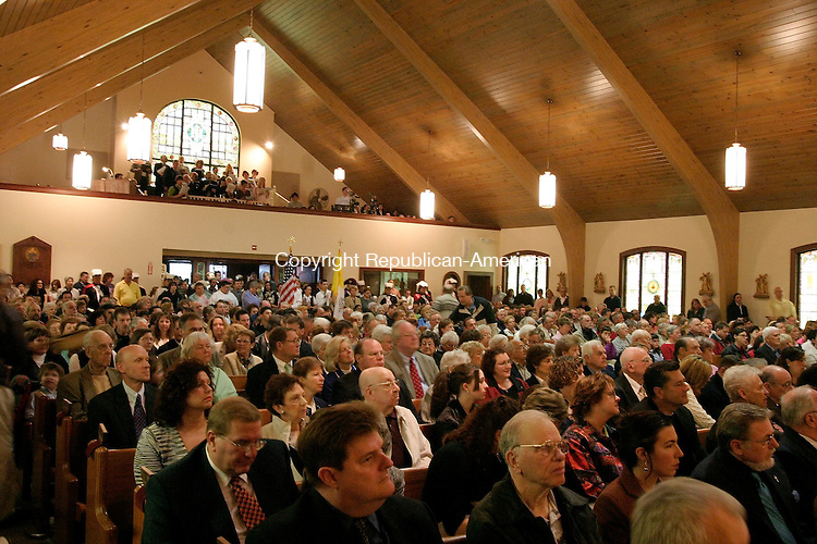 WATERBURY, CT - 01 MARCH 2005 - 050105JS01--Hundreds of parishioners filled the Blessed Sacrament Church in Waterbury during Sunday's Mass to celebrate the restoration. The ceremony was conducted by Archbishop Henry J. Mansell of the Archdiocese of Hartford<br /> --Jim Shannon Photo --Blessed Sacrament Church; Waterbury, Archbishop Henry J. Mansell are CQ