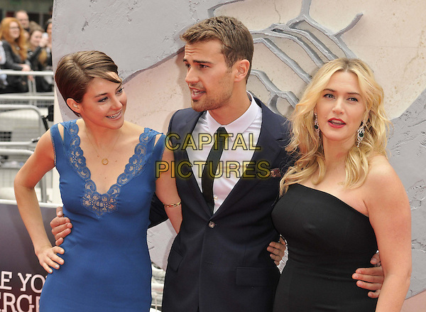 LONDON, ENGLAND - MARCH 30: Shailene Woodley, Theo James &amp; Kate Winslet attend the &quot;Divergent&quot; UK film premiere, Odeon Leicester Square cinema, Leicester Square, on Sunday March 30, 2014 in London, England, UK.<br /> CAP/CAN<br /> &copy;Can Nguyen/Capital Pictures