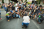 26 MAY 2014 - BANGKOK, THAILAND: Photographers make pictures of a Thai woman who collapsed crying during a protest against the coup in Thailand at Victory Monument during a pro-democracy rally in Bangkok. About two thousand people protested against the coup in Bangkok. It was the third straight day of large pro-democracy rallies in the Thai capital as the army continued to tighten its grip on Thai life.   PHOTO BY JACK KURTZ