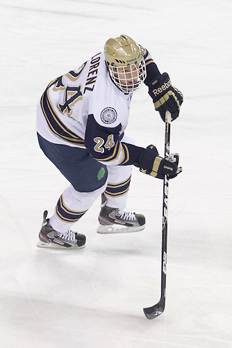 Notre Dame defenseman Sean Lorenz (#24) skates with the puck in action during NCAA hockey game between Notre Dame and Boston College.  The Notre Dame Fighting Irish defeated the Boston College Eagles 3-2 in game at the Compton Family Ice Arena in South Bend, Indiana.