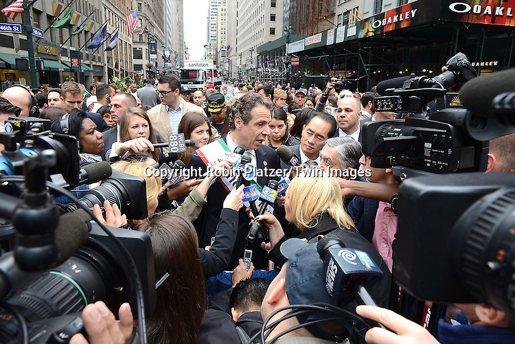 Governor Andrew Cuomo being interviewed  in the 70th Annual Columbus Day Parade on October 13, 2014 on Fifth Avenue in New York City.<br /> <br /> photo by Robin Platzer/Twin Images<br />  <br /> phone number 212-935-0770