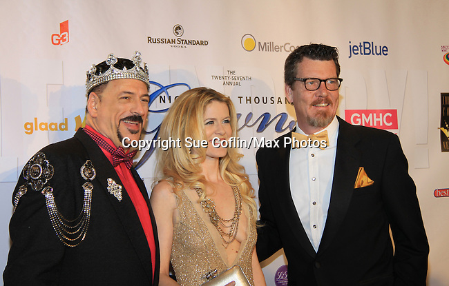 Real Housewife of New York Alex McCord & husband Simon Van Kempen pose with Gary Cosgrove (President and on the Board of Directors) as they attend The 27th Annual Night of a Thousand Gowns benefitting GLAAD and GMHC on April 6, 2013 at The Hilton New York, NYC, NY. Attending: and many more. (Photo by Sue Coflin/Max Photos)
