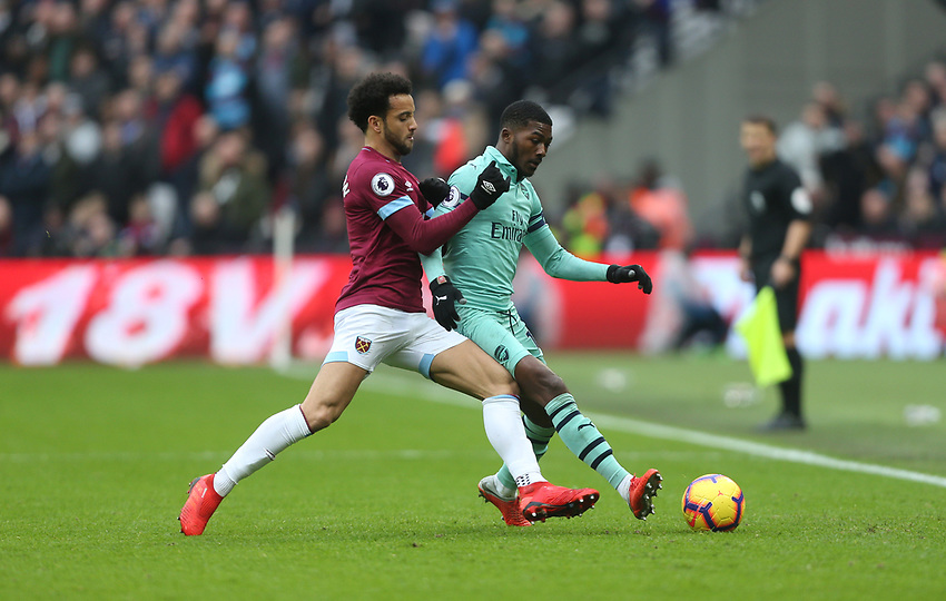 West Ham United's Felipe Anderson and Arsenal's Ainsley Maitland-Niles<br /> <br /> Photographer Rob Newell/CameraSport<br /> <br /> The Premier League - West Ham United v Arsenal - Saturday 12th January 2019 - London Stadium - London<br /> <br /> World Copyright © 2019 CameraSport. All rights reserved. 43 Linden Ave. Countesthorpe. Leicester. England. LE8 5PG - Tel: +44 (0) 116 277 4147 - admin@camerasport.com - www.camerasport.com